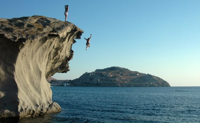 Diving off the cliffs in Limnos