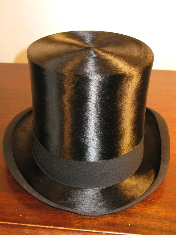 Edwardian Style Vintage Extra Quality Black Silk Top Hat By Cuthbertson Ludgate Hill, Cheapside, Strand & Gresham Street London England Circa 1950 Asimky stunning and beautiful traditional black silk top hat dating from the 1950s made by Cuthbertson of Londons fine hatters. Perfect for the Royal enclosure at Ascot a wedding, any formal occasion or a wonderful display item. In superb vintage condition with very little wear. The interior is pale cream silk with makers mark and leather sweat...