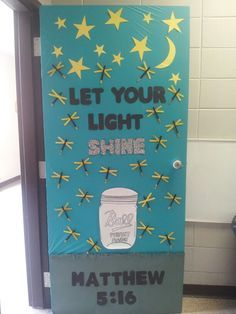 Christian based classroom door. Southern night themed. Mason jar, grass, bible verse, fireflies from popsicle sticks and bottoms dipped in glitter.