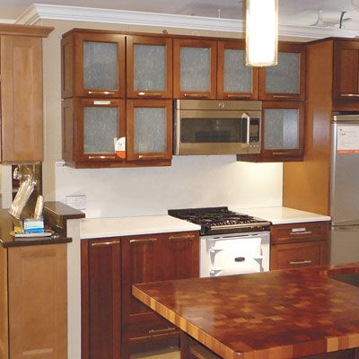 The big guys may not offer the customization you get from a local craftsman, but factory-made-to-order cabinets have the following benefits: 1. Warranties of up to 25 years on cabinets, accessories, workmanship, and internal hardware.2. Controlled environment that yields more stable wood, which reduces warping and splitting later. 3. Computerized cutting tools that offer more precise joinery than anything done by hand.4. Baked-on finishes that are more durable than local guys' air-dried o...