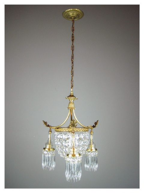 For the master bedroom we chose this early 20th century French Crystal basket light, inviting a warmth and decadence to the bedroom. You cou...