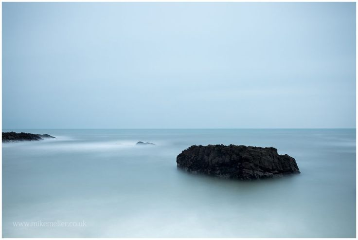 Rocky islands at North Sea in Montrose, SCOTLAND. Calm atmosphere. Seascape photography.