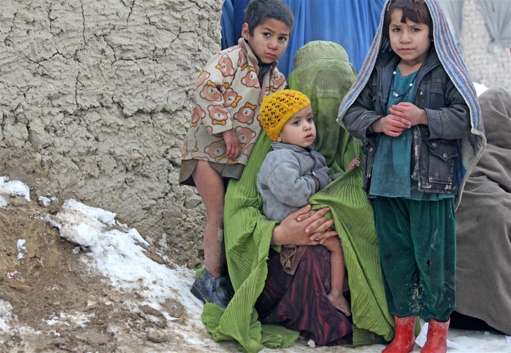 A family at an informal settlement for IDPs in Kabul