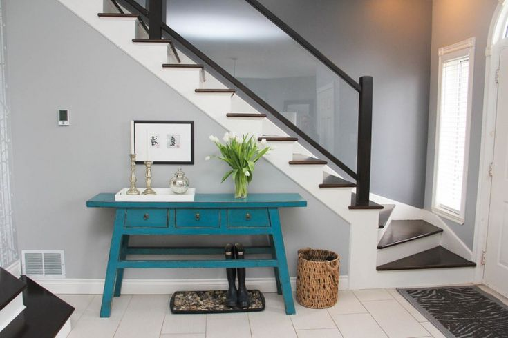 modern entryway table wood staircase white floors large window basket candleholder rug boots framed painting eclectic design of An Awesome Modern Entryway Table List to Get a Look At