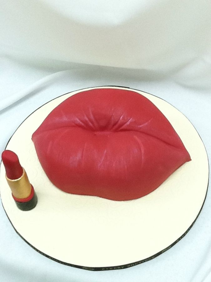 Bakery in Brooklyn custom lips cake with lipstick by Duet Bakery Boutique in Brooklyn, NY.