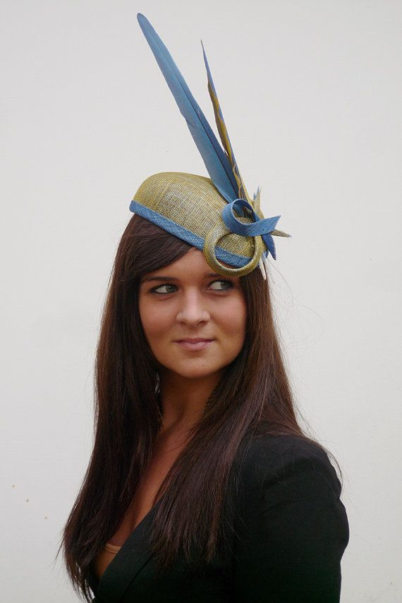Unique handmade sinamay hat with parot by MarcusArtandFashion, $159.00  Looooove, but I don't do feathers :(