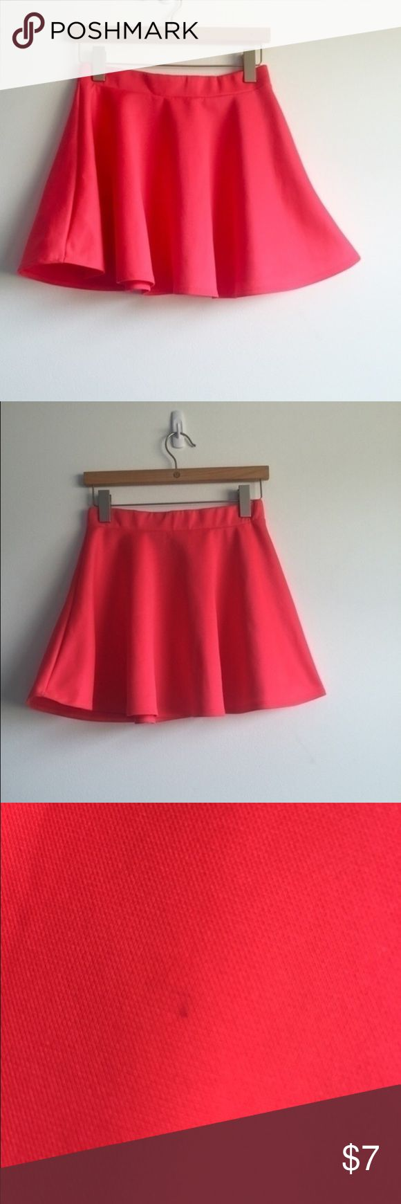 Coral Melon Colored Body Central Skater Skirt Coral-colored skater skirt from Body Central in a size medium (runs a bit smaller). It's really cute and in good condition, there is just a very small stain on one side and a tiny snag on the other Body Central Skirts Mini