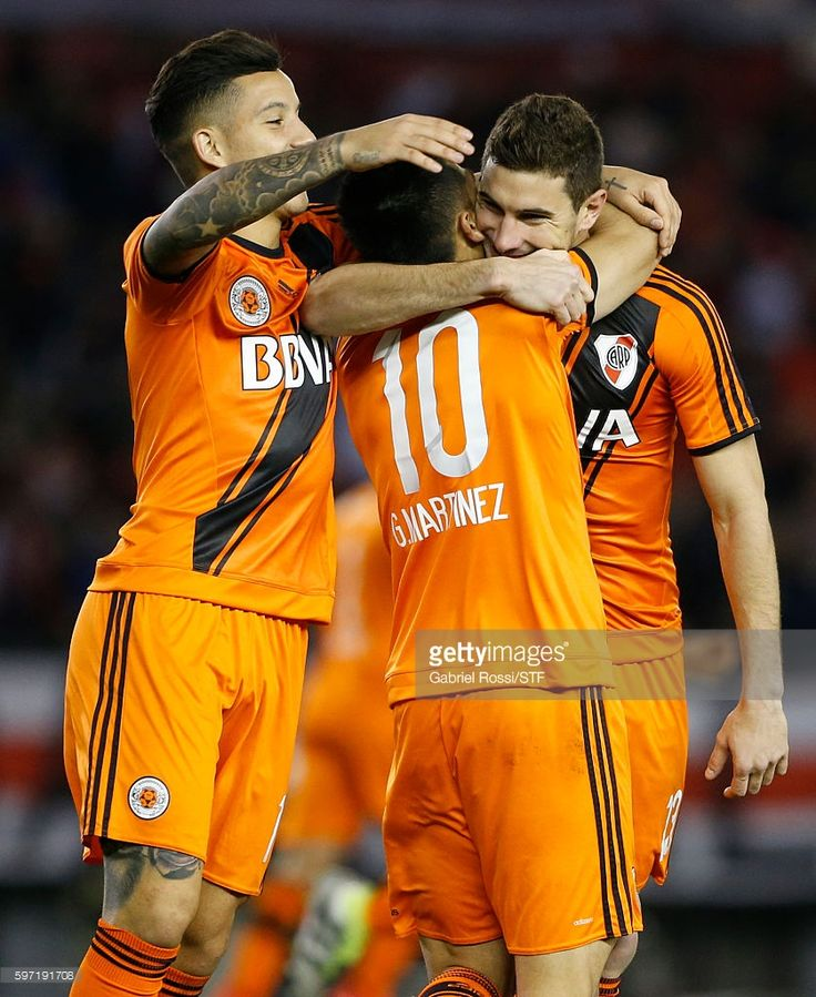 Lucas Alario of River Plate celebrates with teammates Gonzalo Martinez and Sebastian Driussi after scoring the second goal of his team during a match between River Plate and Banfield as part of first round of Campeonato de Primera Division 2016/2017 at Monumental Stadium on August 28, 2016 in Buenos Aires, Argentina.