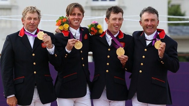 (L-R) Gold medallists Nick Skelton, Ben Maher, Scott Brash and Peter Charles of Great Britain celebrate on the podium after a nail-bitting jump-off with the Netherlands to decide the Team Jumping competition.