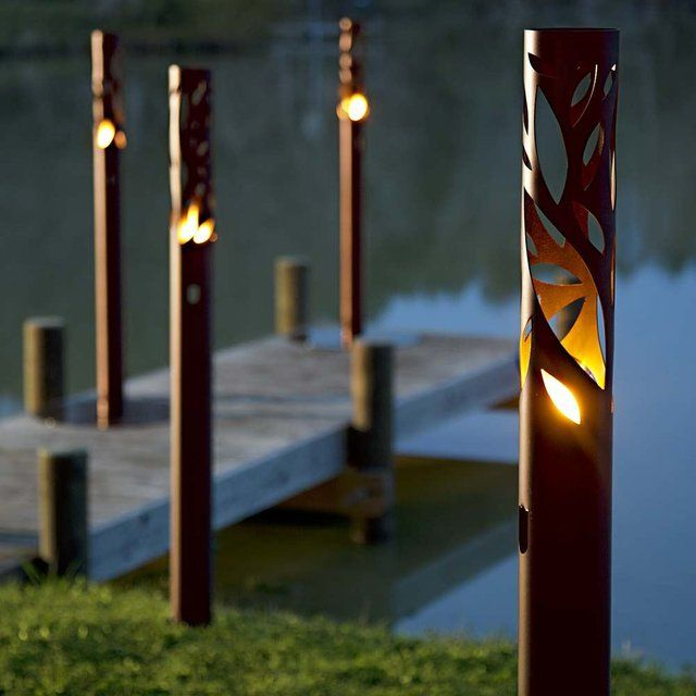 "TWIG (Bronze)Fireburners – Torches Product Dimensions (IN): DIA4"" x H56""Product Weight (LB): 9Product Dimensions (CM): DIA10.2 X H142.2Product Weight (KG): 4 Twig is a slender solid steel frame containing fiery flames that glow from within the bronze epoxy powder-painted structure. Patterned with a random leaf design, Twig references the mood of the autumnal and summer equinoxes, beautifying the indoor and outdoor landscape by alluding to nature in its form. Strong yet sophisticated, Twig…"