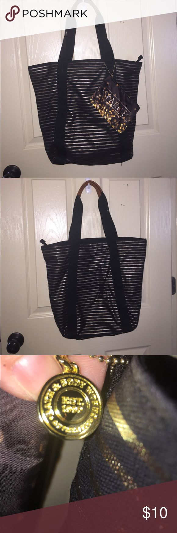 Bath & Body Works Tote Bag Black and gold big tote bags that you buy at Bath & Body Works with products inside.  Never used.  Still has tag.  Also comes with a little tote/make up bag. Bath & Body Works Bags Totes