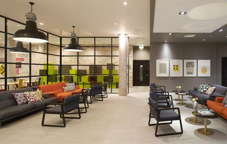 Spring Mews #Student #Living, The Manser Practice #London #British #chill #light #colour #color #shelves #accommodation #home #amenity #lobby #orange #green #grey #brick #comfy #seat #elegant #design #interior #modern #comtemporary #stylish