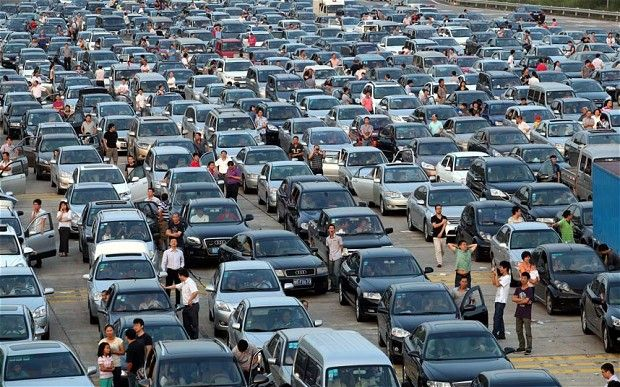 I truly hate communism. --> A decision to grant free road travel meant hundreds of thousands of Chinese drivers spent the first day of the mid-autumn festival in gridlock.