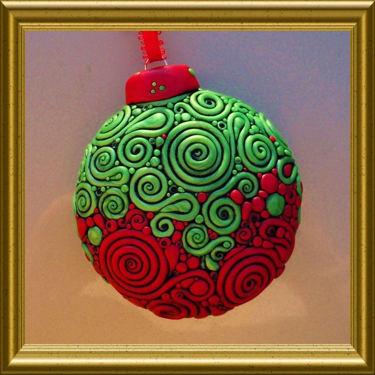 Filigree x-mass ornament made with a glass ball & clay