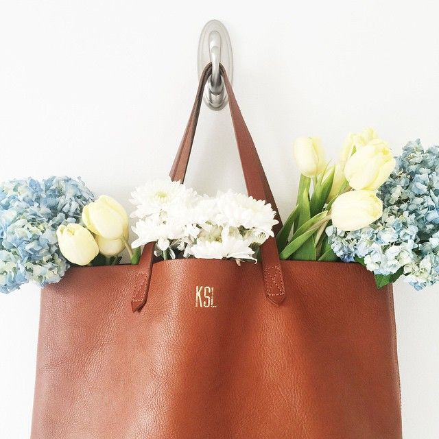 obsessed with this brown monogrammed leather tote