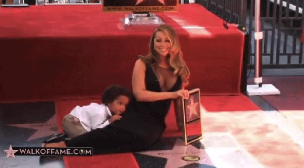 Including when her son joined her for pictures and she basically ignored his existence. | This Vine Of Mariah Carey Posing While Her Child Is Dragged Away From Her Is Iconic