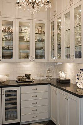 This picture describes a Butler's pantry, but it can be done in a kitchen, too.  As space allows, dedicating one or more glass front cupboards for silver, fine china, or other collectibles can be done in any kitchen.  If possible, I recommend  puck lights and glass shelving as shown in the picture.