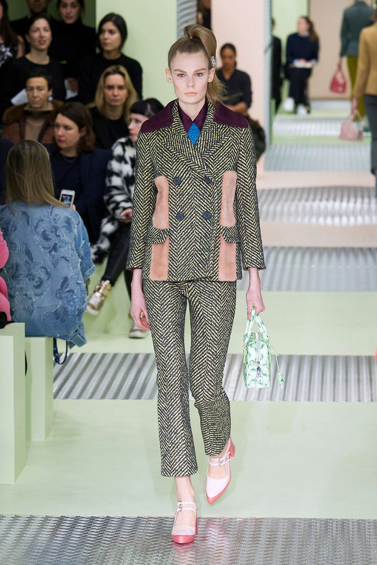 The runways didn't hold back on rich fabrications borrowed from traditional menswear. Tweed, herringbone and houndstooth found their way onto modern tailored silhouettes. These are the new stories in suiting.  Pictured: Prada   - HarpersBAZAAR.com