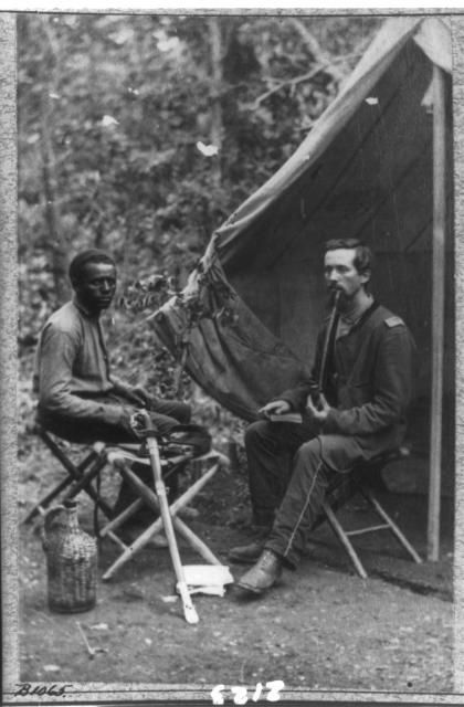 Photo: Library of Congress (LOC) 1865Two soldiers, one white and one black, smoking a long pipe in front of a tent When Fort Sumter was fired upon, in April 1861, black men raced to sign up for military service with the North (though some blacks did fight for the Confederacy as well) but were turned away at first. A 1792 law forbade black people from bearing arms in the U.S. Army. Resolutions were made asking the government to change the law, but nothing happened quickly.