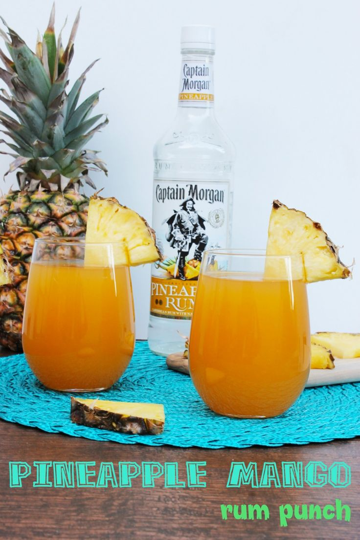 This pineapple mango rum punch is the perfect summer cocktail recipe! It's ideal for summer cook outs & pool parties....plus that Captain Morgan's pineapple rum? DELISH!