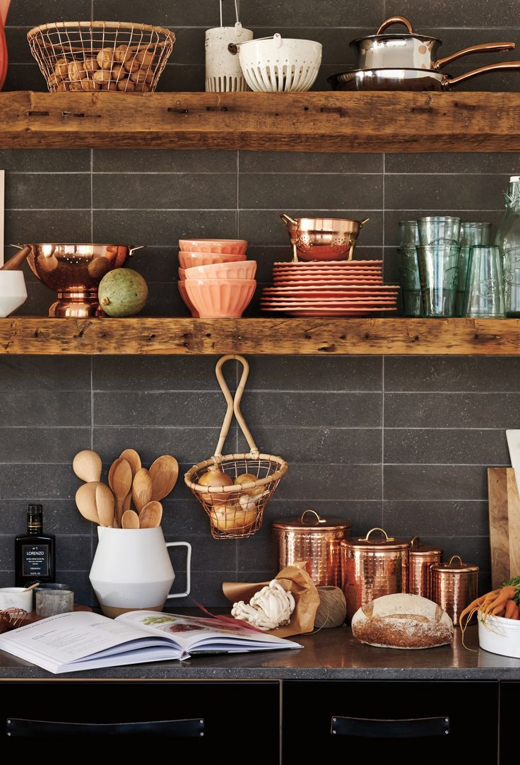 Opt for brass hues against wooden and stone interior for a modern Kitchen with a country twist.