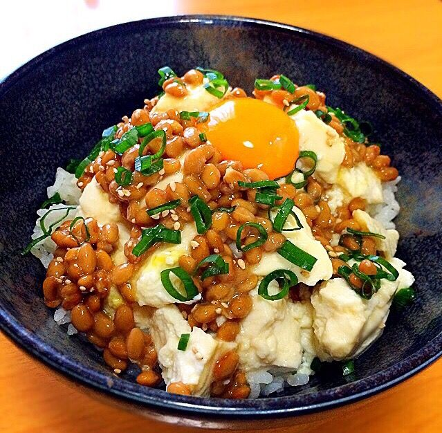Natto, raw egg, tofu and rice bowl. its yummy to add Okra, too. Soy sauce or dashi soup.