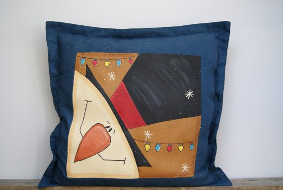 Snowman Pillow, Decorative Pillow, Christmas Pillow, Hand Painted Pillow, Blue Button Pillow, Throw Pillow, Frosty Pillow, Snowman Decor, Country Home Decor, Pillow   The front of this cobalt blue decorative throw pillow has been painted a cocoa and flecked with buttercream, the edges have been distressed with a burnt brown. A jolly snowman wearing a top hat has been hand painted on along with a couple strings of Christmas lights. The artwork has been sealed with spar-urethane to help…