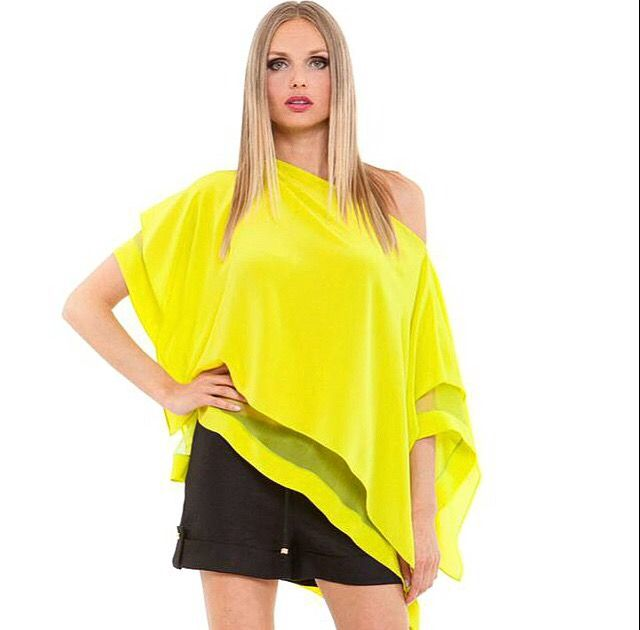 $209 This bright yellow silk Analili top features a wide boat neckline, an off-the-shoulder effect, and layered open sleeves for a perfect spring feel http://jolieboutique.com/shirts-tops/frita-silk-top?limit=25