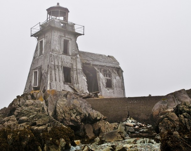 """Ross Island Lighthouse - *Grand Manan, New Brunswick, Canada*"" -- [Ross Island lighthouse in the fog, built in 1878 on Grand Manan, New Brunswick, Canada. You can walk to the island at low tide but for a short time either side of the low tide before the tide returns quite quickly, and the path is dangerous if it's under water. Therefore time is of great importance so as not to get trapped on the island.]~[Photo & caption by Roger Lewis]~[h4d-1032013]"
