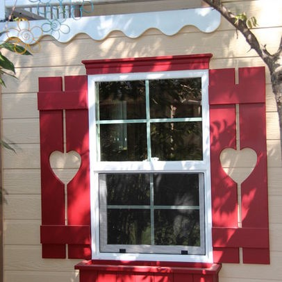exterior window shutters with decorative cutouts. board and batten shutters with heart cutouts. like the window header wavy trim. exterior decorative cutouts o