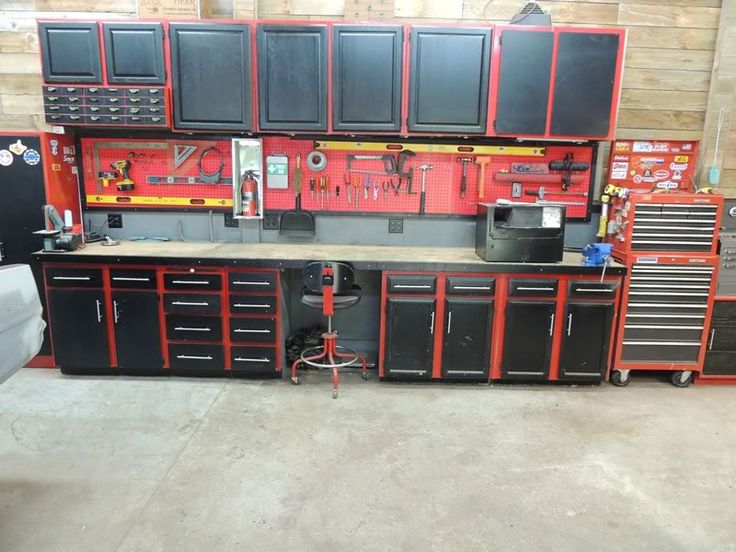 Wooden walls, repurposed kitchen cabinets painted red with black doors.  Garage organization ideas for little money.  The Garage Journal Board