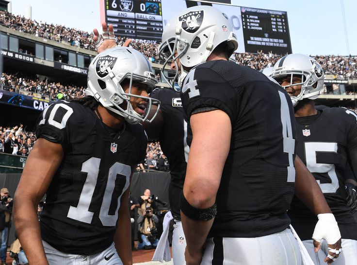 Nov 27, 2016; Oakland, CA, USA; Oakland Raiders wide receiver Seth Roberts (10) celebrates with quarterback Derek Carr (4) his touchdown scored against the Carolina Panthers during the first half at Oakland-Alameda County Coliseum. (4104×3043)