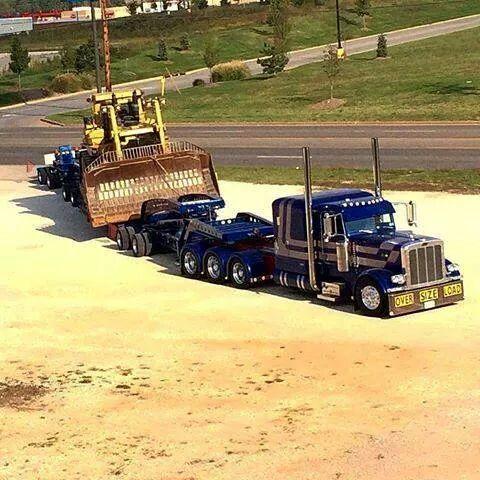 Peterbilt custom 379 heavy haul with a Cat on wagon
