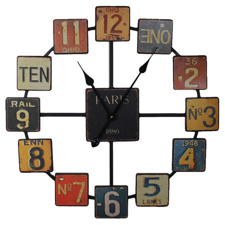 Metal wall clock with multicolor license plate-inspired numbers and an open design.  Product: Wall clockConstruction...