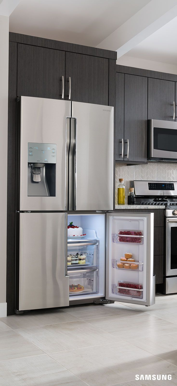 The stainless steel Samsung 4-Door-Flex Refrigerator is the perfect complement to a sleek, modern kitchen design. Its clean, symmetrical lines add an enviable wow factor when paired with dark stained wooden cabinetry and marble countertops. The fridge is also equipped with the latest technology utilized in the customizable temperature in-door control panel to help your family's favorite foods stay fresh - or frozen - longer.