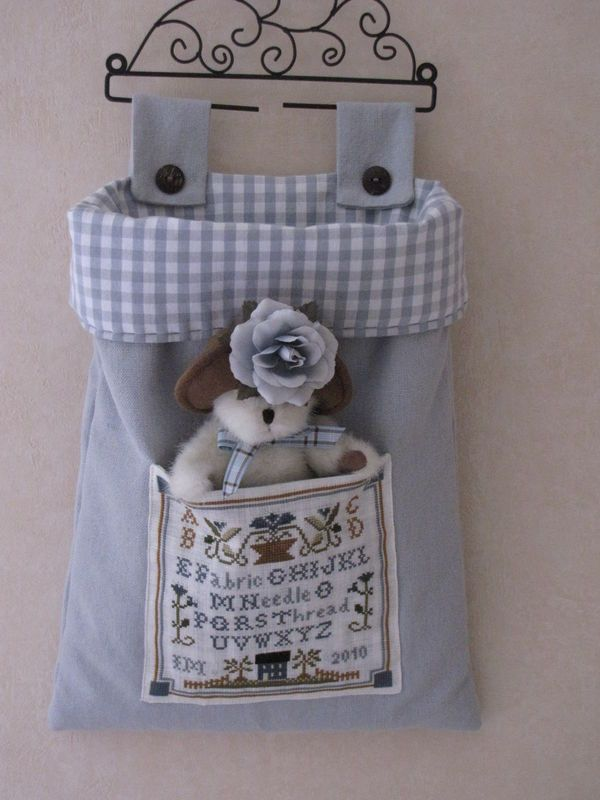 Look at tabs, gingham cuff, pocket for bear.  Lovely little hanging bag.
