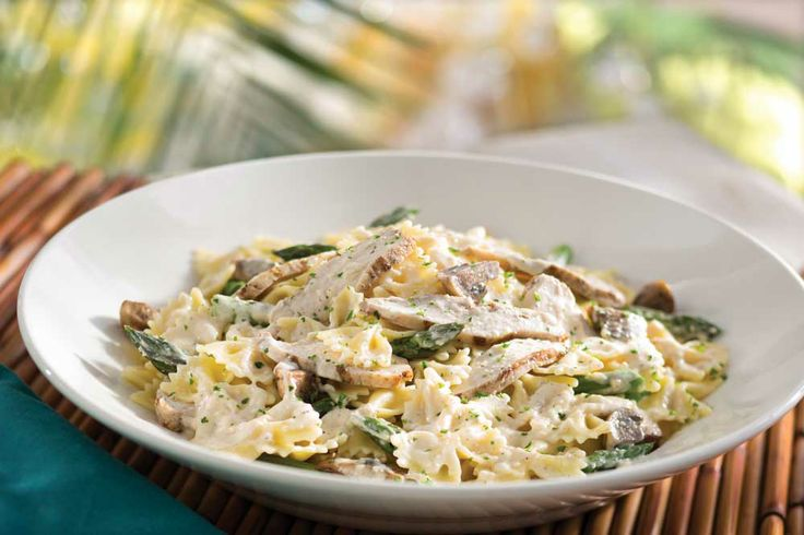 Our Jerk Chicken Pasta is made with sliced jerk chicken breast, fresh asparagus and mushrooms tossed in a Parmesan cream sauce with bow-tie pasta.