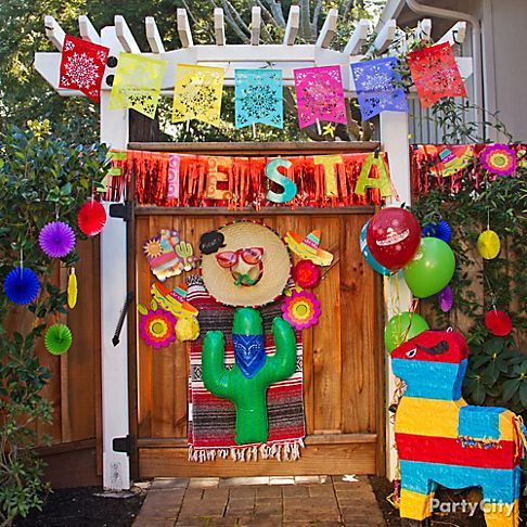 Get the fiesta started as soon as your guests walk through the door (or gate!) by decking out the entrance, Mexico style.