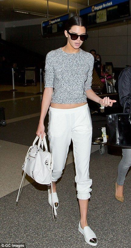 Kendall Jenner.. Topshop Sweater and Joggers, Miu Miu Sneakers, and Balenciaga Arena City bag..... - Celebrity Fashion Trends