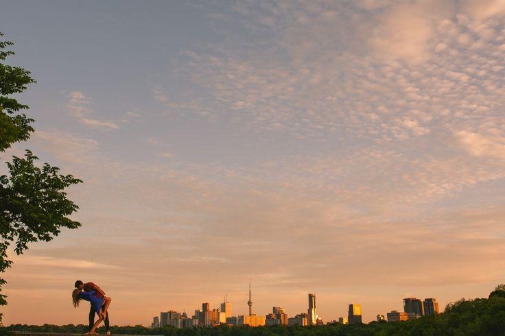 When was the last time someone kissed you like that? Toronto skyline sunset. Toronto Wedding photographer Niv Shimshon