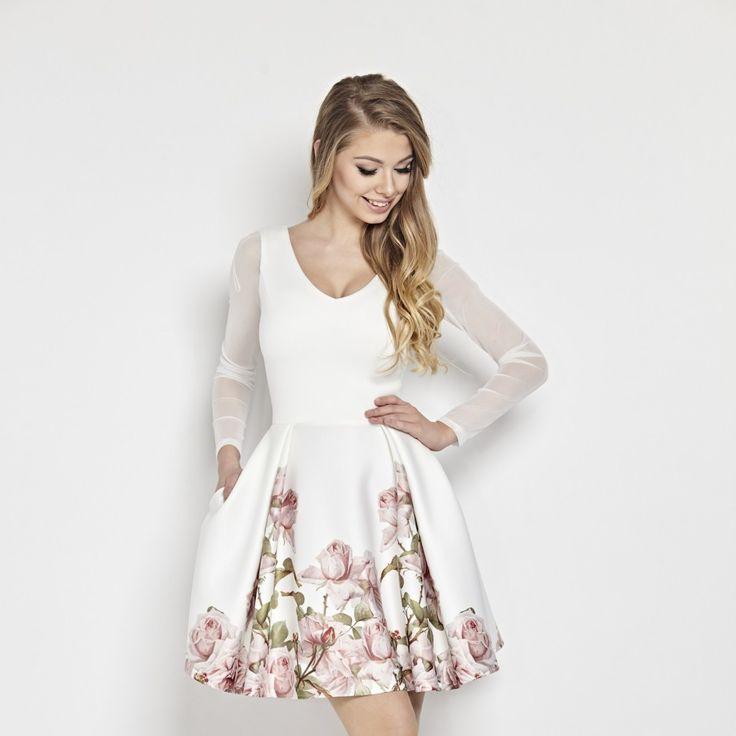 Bílé společenské šaty s květy Betty M Casablanca Dokonalý kousek nejen pro mladé dámy, ale i všechny majitelky štíhlých nohou a úzkých pasů. Nádherné šaty vhodné pro nevěsty, družičky či svědkyně na svatby, na zahradní párty, na dovolenou, na večírek s kamarádkami. Bílý podklad s potiskem květů na sukni, výstřih do V, dlouhý rukáv v tylovém provedení. Sukně nabraná v pravidelných skladech díky materiálu skvěle drží tvar. Boční kapsy, zapínání na zip v zadní části, podšívka. Trendy materiál…