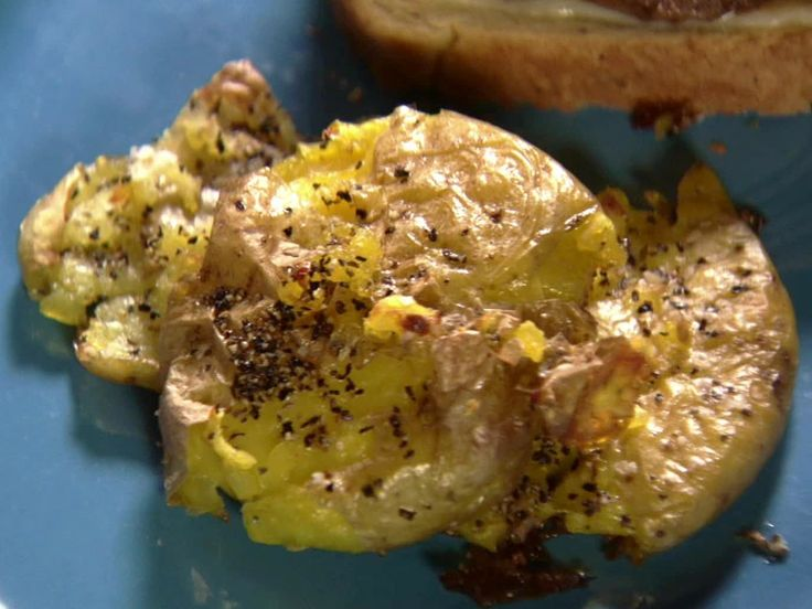 Crash Hot Potatoes - Pioneer Woman 12 small yellow potatoes Kosher salt 3 tablespoons olive oil Fresh ground black pepper Boil for 12 minutes, smash with potato masher on oiled cookie sheet, drizzle with oil or 1 pat or butter, salt/pepper/cheddar/bacon bits, bake 475 for 15 mins.