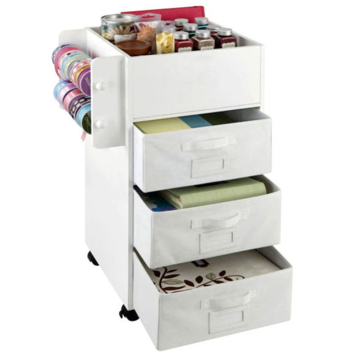 Recollections™ Mobile Craft Storage Center $90 Three drawers, two ribbon dowels and a deep embellishment holder with movable dividers let you keep all of your craft supplies organized and convenient.