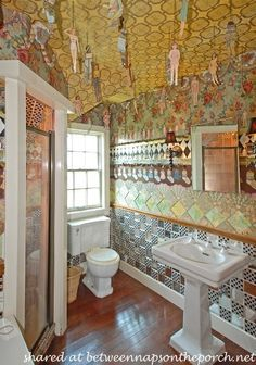 There's even a bathroom decorated with paperdolls.  In an online interview I watched, Victoria said this room is all about paper, down to the paper dolls.  So, I guess all the walls are decorated with wallpaper, too.