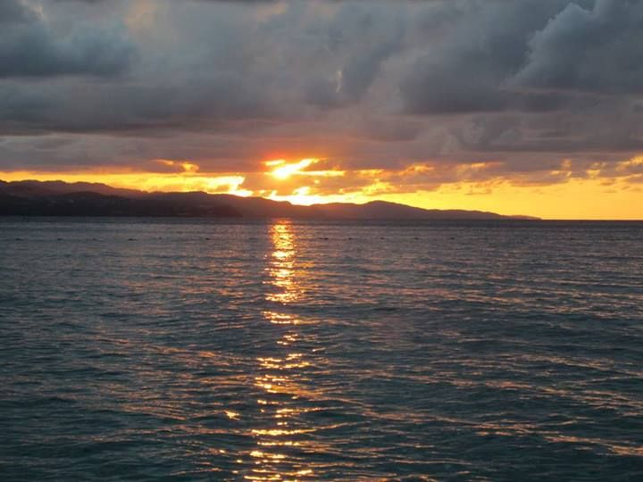 Sunset as seen from Hipstrip, Montego Bay http://www.jamaica-republic.com/ackee-tree-lounge.html