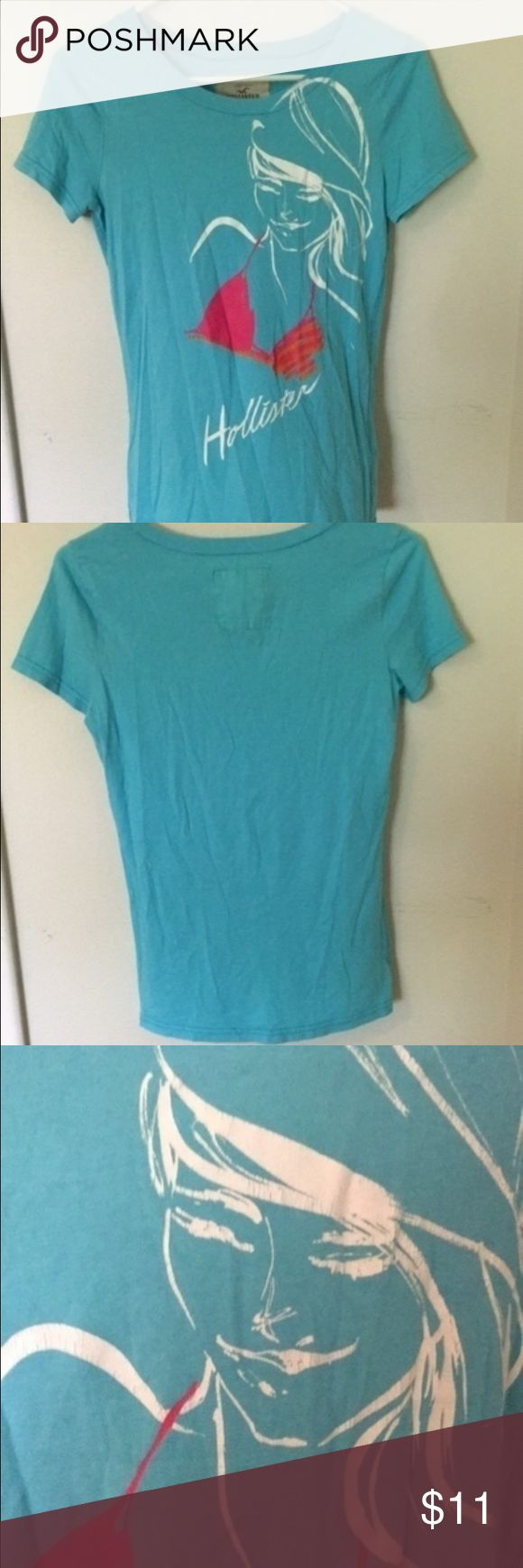 Hollister Graphic Tee Light blue graphic tee. Girl in bikini top. White, pink, and orange. Great condition. Hollister Tops Tees - Short Sleeve