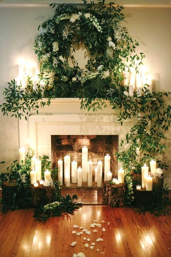 a beautiful fireplace with candles inside around and on the mantel rh pinterest com