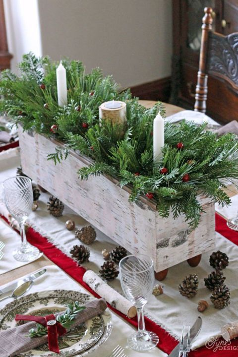 A handmade wood box not only creates a focal point in a dining room, but can also be easily used throughout the rest of the year as table decor. See more at Fynes Designs.
