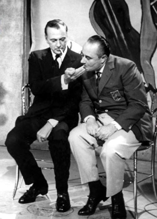 "Gary Cooper, guest star at ""Il Musichiere"", and Mario Riva in the course of the show (1959)."