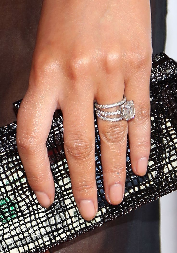 Chrissy's simple (well, relatively) wedding bands surround her huge cushion-cut diamond engagement ring, giving her look a giant dose of sparkle at all times.  - GoodHousekeeping.com